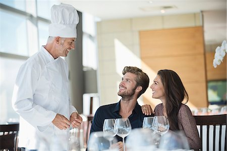 Chef talking to couple at restaurant Stock Photo - Premium Royalty-Free, Code: 6108-06906770