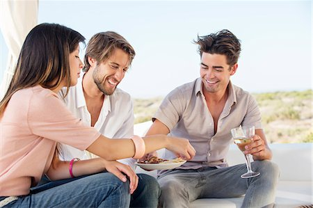 snack - Three friends enjoying snacks and drinks in outdoor Stock Photo - Premium Royalty-Free, Code: 6108-06906797