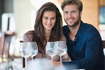 property release - Portrait of a couple enjoying white wine in a restaurant Stock Photo - Premium Royalty-Free, Code: 6108-06906725