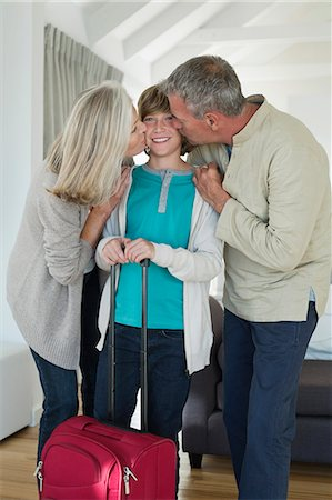 preteen kissing - Grandparents kissing their grandson at home Stock Photo - Premium Royalty-Free, Code: 6108-06906847