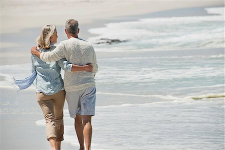 senior lady walking - Rear view of a couple walking on the beach Stock Photo - Premium Royalty-Free, Code: 6108-06906846