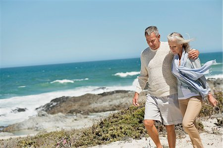 Couple walking on the beach Stock Photo - Premium Royalty-Free, Code: 6108-06906860