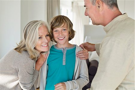 preteens pictures older men - Grandparents hugging their grandson at home Stock Photo - Premium Royalty-Free, Code: 6108-06906879