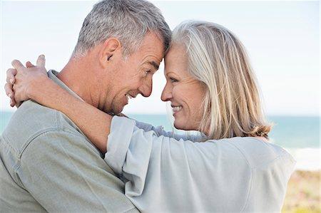 Romantic couple enjoying on the beach Stock Photo - Premium Royalty-Free, Code: 6108-06906883