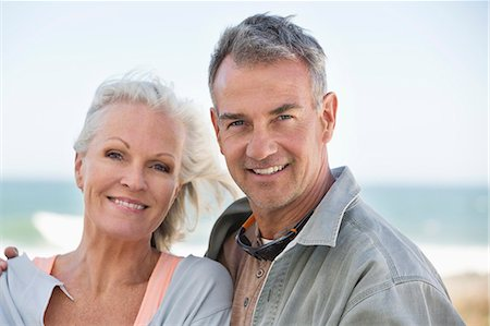 Portrait of a couple smiling on the beach Stock Photo - Premium Royalty-Free, Code: 6108-06906886