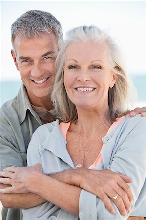 Portrait of a couple smiling Stock Photo - Premium Royalty-Free, Code: 6108-06906889