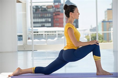 stretching (people exercising) - Woman exercising on exercise mat in a gym Stock Photo - Premium Royalty-Free, Code: 6108-06906952