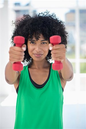 practise - Woman exercising with dumbbells Stock Photo - Premium Royalty-Free, Code: 6108-06906929