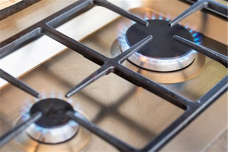 stove - Close-up of a gas stove burner Stock Photo - Premium Royalty-Free, Code: 6108-06907073