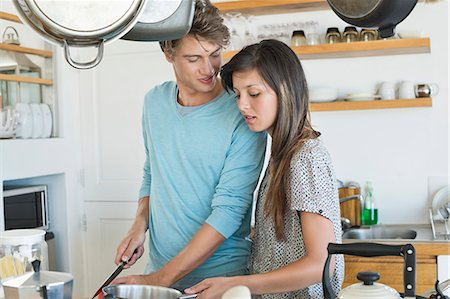 Couple cooking in the kitchen Stock Photo - Premium Royalty-Free, Code: 6108-06907082