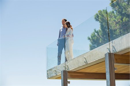 Couple standing together on a terrace Stock Photo - Premium Royalty-Free, Code: 6108-06907134