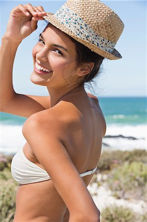 Beautiful woman enjoying on the beach Stock Photo - Premium Royalty-Free, Code: 6108-06907241