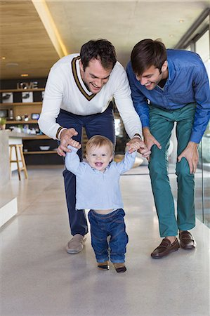 Parents helping their son to walk Stock Photo - Premium Royalty-Free, Code: 6108-06907344