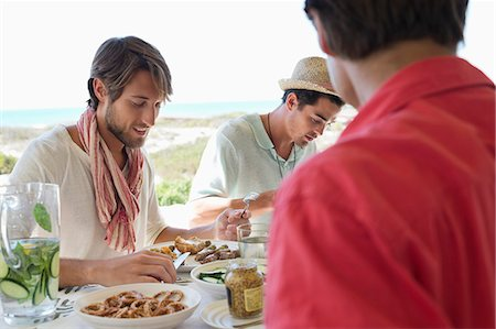 friend - Friends eating lunch at dining table Stock Photo - Premium Royalty-Free, Code: 6108-06907363