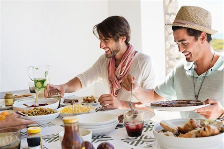 people eating at lunch - Friends eating lunch at dining table Stock Photo - Premium Royalty-Free, Code: 6108-06907361