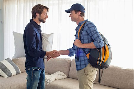 Man shaking hands with his friend Stock Photo - Premium Royalty-Free, Code: 6108-06907331