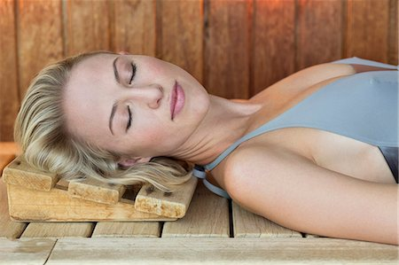 Close-up of a woman resting in a sauna Stock Photo - Premium Royalty-Free, Code: 6108-06907451