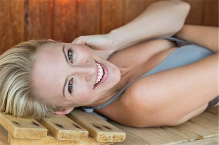 Portrait of a smiling woman relaxing in a sauna Stock Photo - Premium Royalty-Free, Code: 6108-06907466