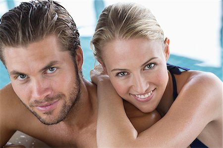 shirtless men - Portrait of a smiling couple at the poolside Stock Photo - Premium Royalty-Free, Code: 6108-06907476