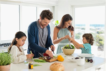 Family preparing food Stock Photo - Premium Royalty-Free, Code: 6108-06907545