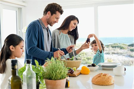 Family preparing food in the kitchen Stock Photo - Premium Royalty-Free, Code: 6108-06907557