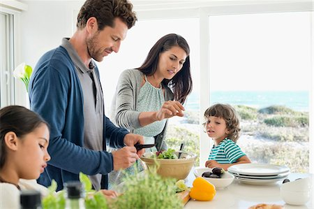 Family preparing food in the kitchen Stock Photo - Premium Royalty-Free, Code: 6108-06907588