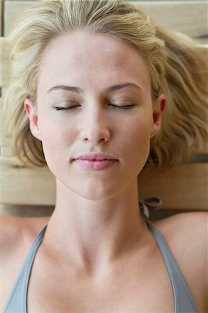 Close-up of a woman resting in a sauna Stock Photo - Premium Royalty-Free, Code: 6108-06907534