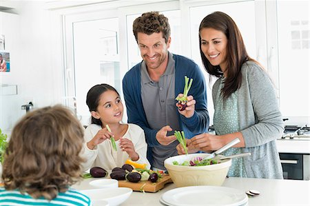 Family preparing food in the kitchen Stock Photo - Premium Royalty-Free, Code: 6108-06907607