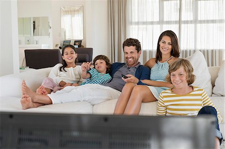 Family watching television Stock Photo - Premium Royalty-Free, Code: 6108-06907610