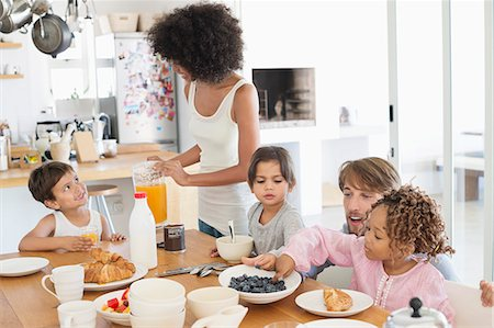 Family at breakfast table Stock Photo - Premium Royalty-Free, Code: 6108-06907633