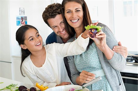 Couple with their daughter enjoying in the kitchen Stock Photo - Premium Royalty-Free, Code: 6108-06907638
