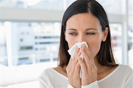 people coughing or sneezing - Close-up of a woman sneezing Stock Photo - Premium Royalty-Free, Code: 6108-06907760