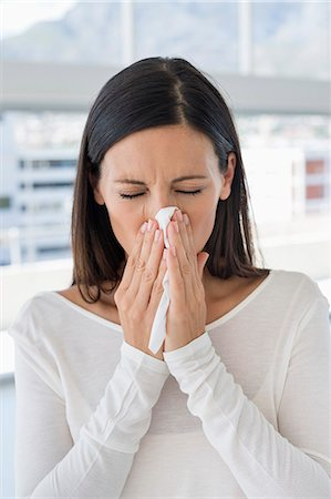 people coughing or sneezing - Close-up of a woman sneezing Stock Photo - Premium Royalty-Free, Code: 6108-06907761