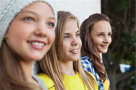 Close-up of three girls smiling together Stock Photo - Premium Royalty-Free, Code: 6108-06907705