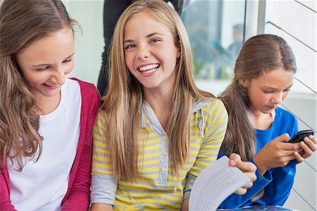 school - Students having fun in a school Stock Photo - Premium Royalty-Free, Code: 6108-06907708