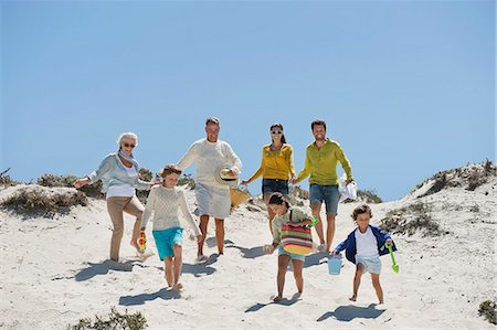 Family walking on the beach Stock Photo - Premium Royalty-Free, Code: 6108-06907887
