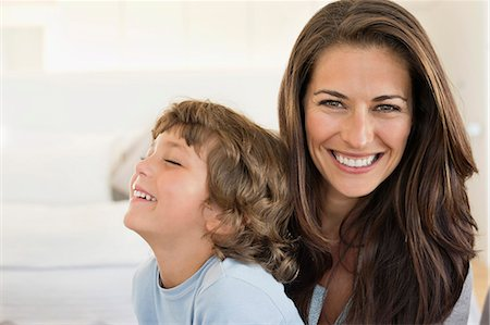 Portrait of a woman and her son smiling Stock Photo - Premium Royalty-Free, Code: 6108-06907895
