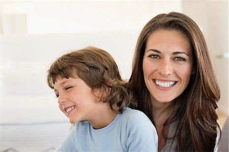 Portrait of a woman and her son smiling Stock Photo - Premium Royalty-Free, Code: 6108-06907896