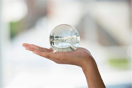 Close-up of a person's hand holding a crystal ball Stock Photo - Premium Royalty-Free, Code: 6108-06907802