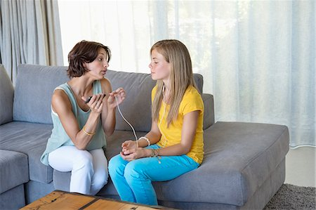 Woman talking to her daughter Stock Photo - Premium Royalty-Free, Code: 6108-06907835