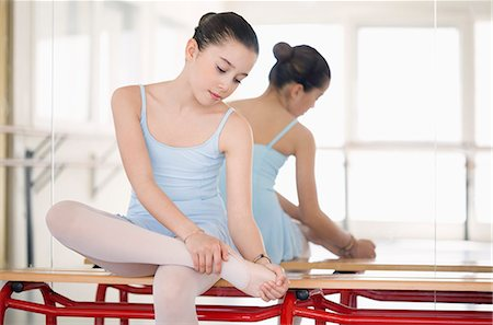Girl stretching Stock Photo - Premium Royalty-Free, Code: 6108-07969535