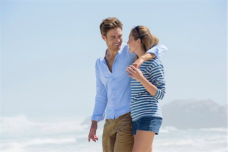 Happy couple walking on the beach Stock Photo - Premium Royalty-Free, Code: 6108-08662357