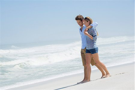 Couple walking on the beach Stock Photo - Premium Royalty-Free, Code: 6108-08662356