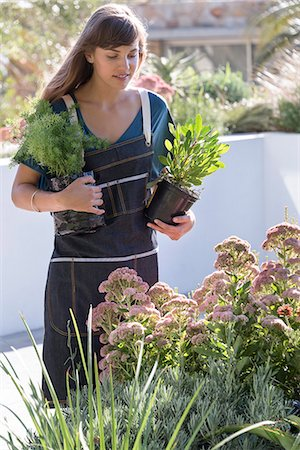 Beautiful young woman gardening Stock Photo - Premium Royalty-Free, Code: 6108-08662464