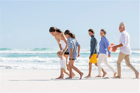 Multi-generation family enjoying on the beach Stock Photo - Premium Royalty-Free, Code: 6108-08663071