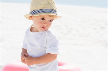 Close-up of a baby boy on the beach Stock Photo - Premium Royalty-Free, Code: 6108-08663083