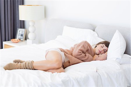 side - Beautiful young woman sleeping on the bed Stock Photo - Premium Royalty-Free, Code: 6108-08663290