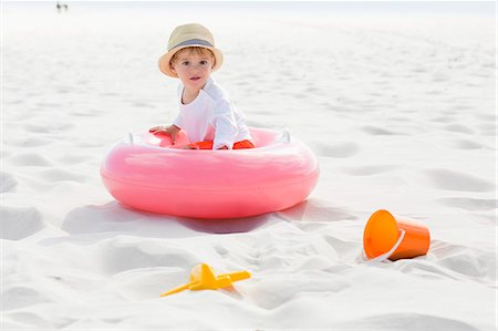 Baby boy playing on the beach Stock Photo - Premium Royalty-Free, Code: 6108-08663401