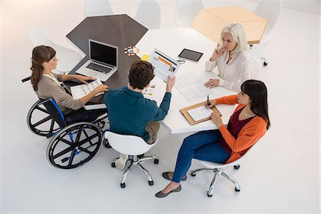 Business people discussing in an office Stock Photo - Premium Royalty-Free, Code: 6108-08725363