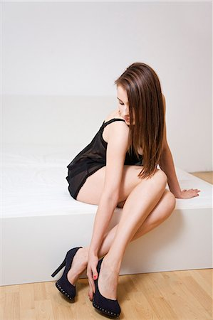 Woman in lingerie and high heels Stock Photo - Premium Royalty-Free, Code: 6108-08908983